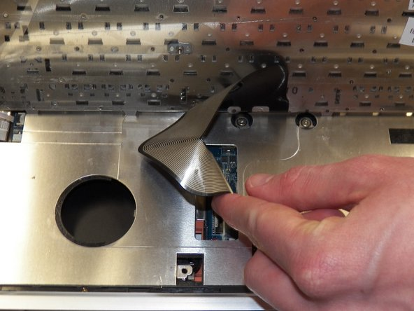 Image 1/2: Gently pull the ribbon cable from the connector housing.