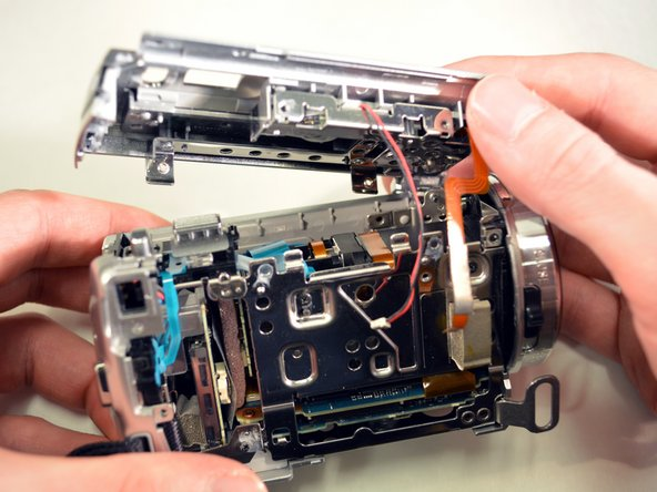 Image 2/2: Set the top case panel aside./'''Set the device aside.'''