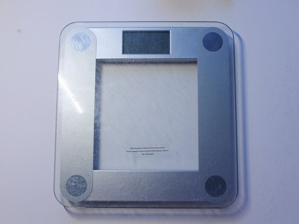 The LO message on the screen indicates that your digital weight scale is running on low battery so you need to get the replacement battery.
