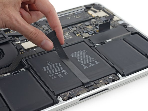 The mystery of the Force Touch trackpad unfolds layer by layer as we first remove its cable.
