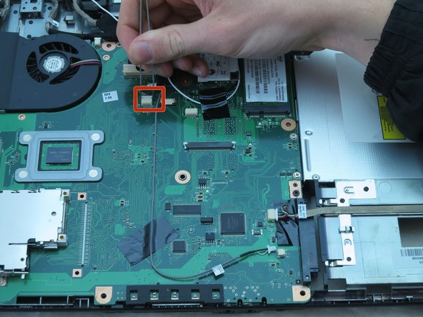 Using your fingers, remove the large connector from the top right corner of the motherboard.
