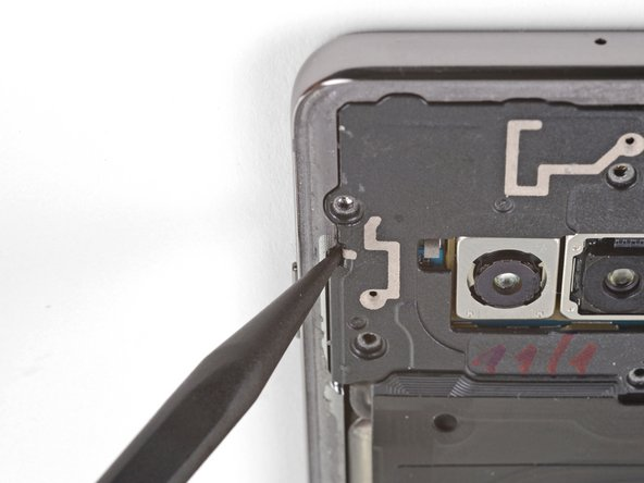 Insert the point of a spudger into the notch on the left edge of the phone, located near the power button.