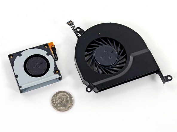 Image 3/3: How small, you ask? Here's how the Surface Pro fan compares to a [product|IF161-059|2011 MacBook Pro] fan and [http://en.wikipedia.org/wiki/Dime_(United_States_coin)|FDR's face].
