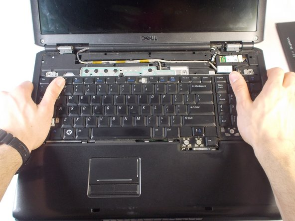 Push the keyboard upwards with your thumbs to disconnect it.