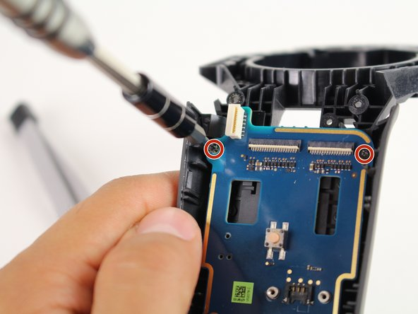 Use the Phillips 00 screwdriver to remove the two black 5.8mm screws from the top of the motherboard.