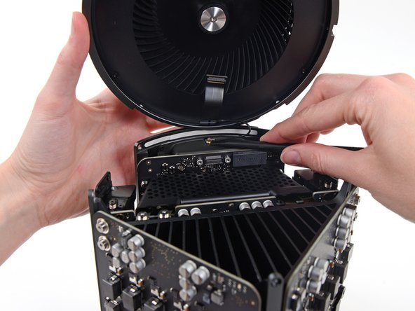 Image 1/1: Remove the fan assembly from the Mac Pro.