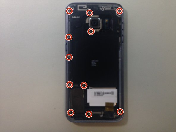 Using a Phillips #00 screw driver bit, remove the 11 screws holding the plastic covers, loudspeaker, and NFC antenna on.