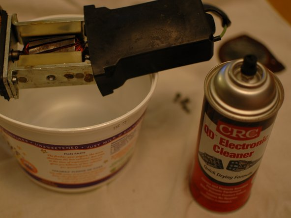Place the electric motor portion of the device over a container that can catch drips as you clean it.