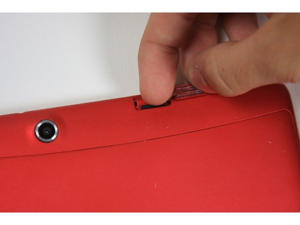 Image 1/3: Once the card pops out, use your finger to pull the card completely out of the SD card slot.