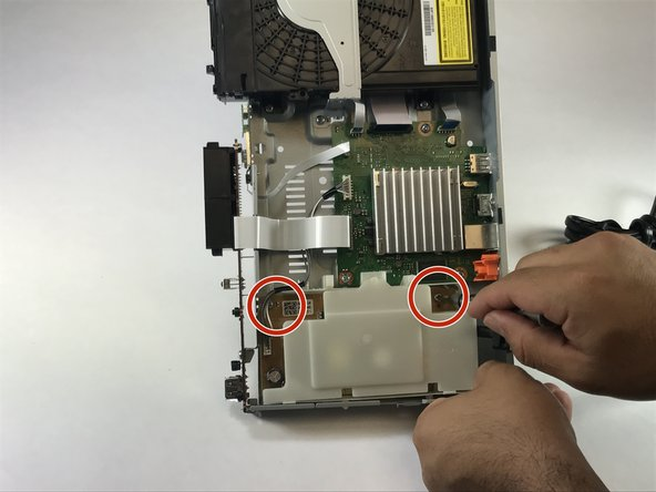 Remove both screws using the Phillips screw driver.
