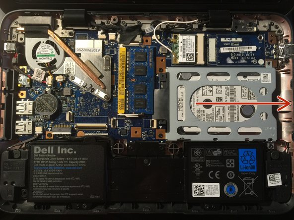 With the screws removed, the hard drive will slide from the left to right, disconnecting it from the hard drive port.