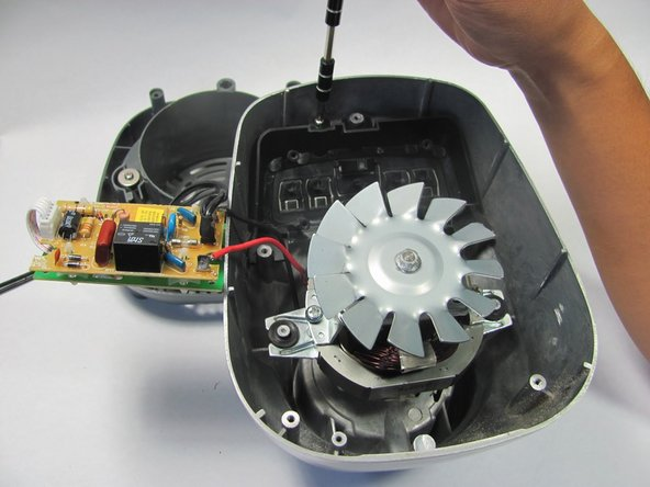Once the circuit board has been freed from its screws it can be moved out of the way to gain access to the buttons.