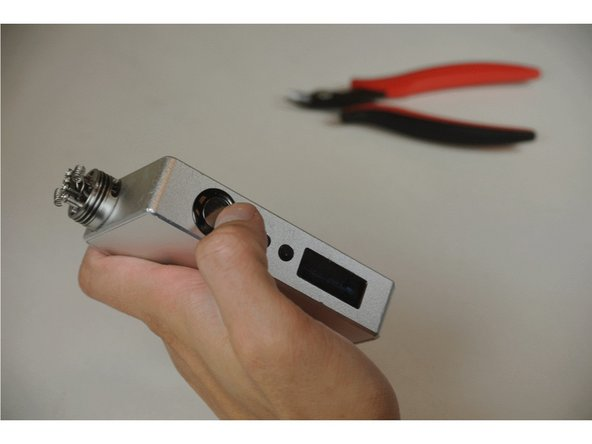 Re-insert the batteries and press the large button 5 times quickly to turn the vape on.