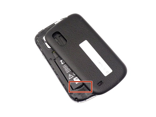 Remove the battery by the notch in the back plate.