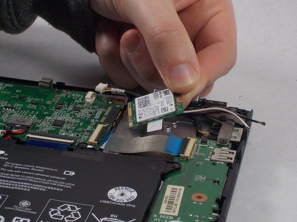 Slide the network card out to the right to remove it from the motherboard.