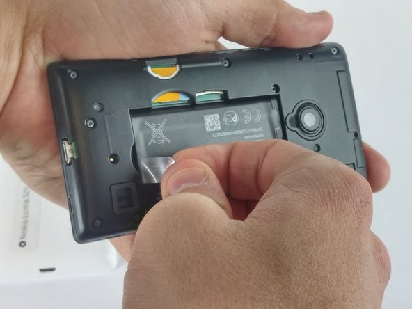 Once the cover has been removed, the battery will be visible. Grab the plastic tab and pull it to remove the battery from its place. If there is no plastic tab, use the plastic opening tool to pry the battery loose.