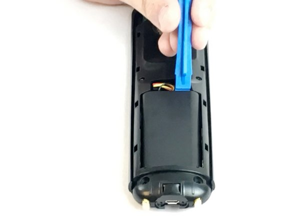Use the Opening Tool to lift the battery out of the case.