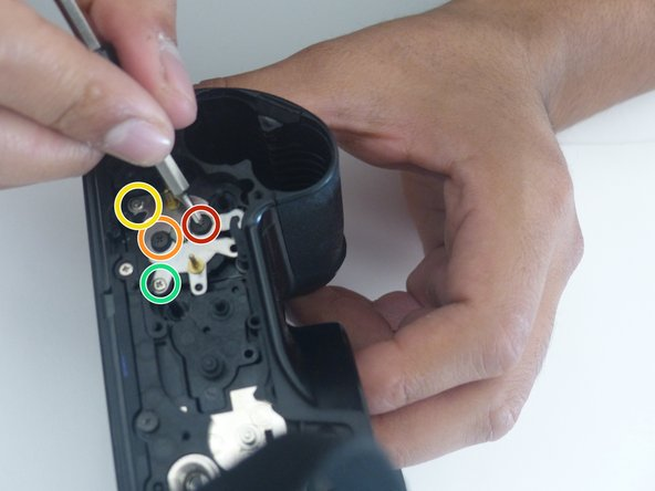 Remove the four screws in the picture using a PH000 screwdriver bit.