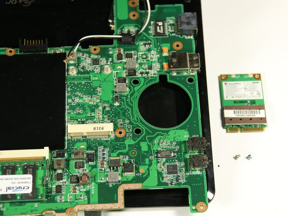 Image 3/3: Note the motherboard is also completely detached from the netbook in this step.