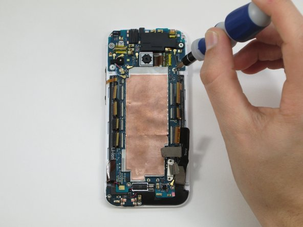 Once the screws are removed, carefully pull the copper plated motherboard out.