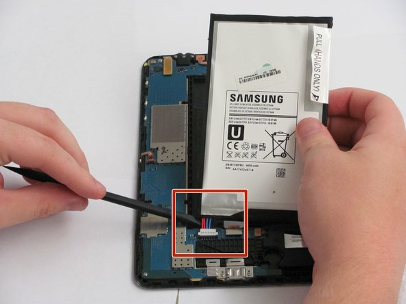Use the spudger to disconnect the battery connector by running it along the underside of the battery.