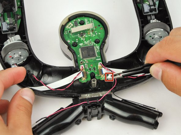 Use the precision tweezers to pull out the red and black wire attached to the white plug at the bottom side of the circuit board.