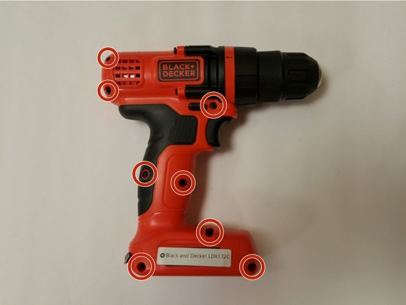 Rotate the drill to it's left side - the chuck should be facing rightward. Locate and remove the eight #2 X 5mm Phillips fasteners from the body of the drill.