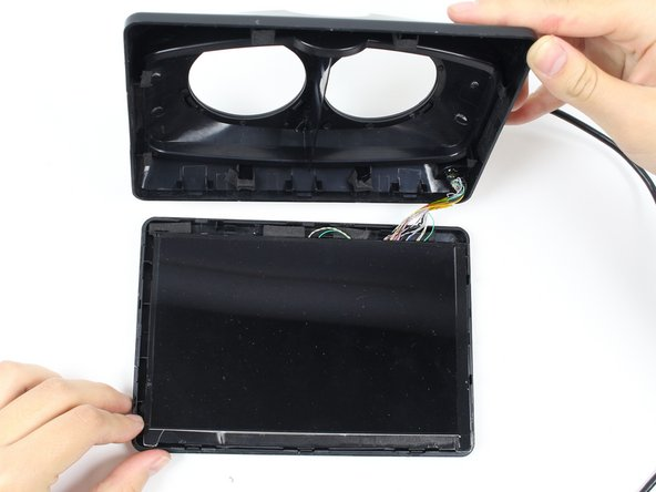 Using the plastic opening tool, pry open the display box to reveal the LCD (Liquid Crystal Display) screen. Run the plastic opening tool around all four edges. Prying open the box may take a good amount of force.