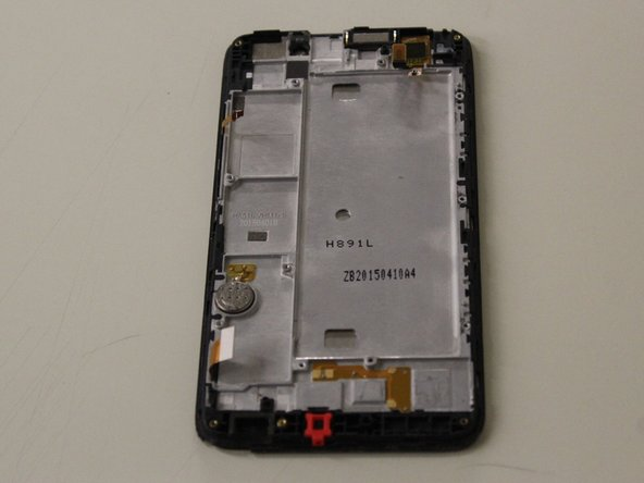 Once the battery is removed the screen will be visible.