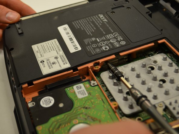 Using the screwdriver, push the CD drive out of the laptop through the panel exposure.