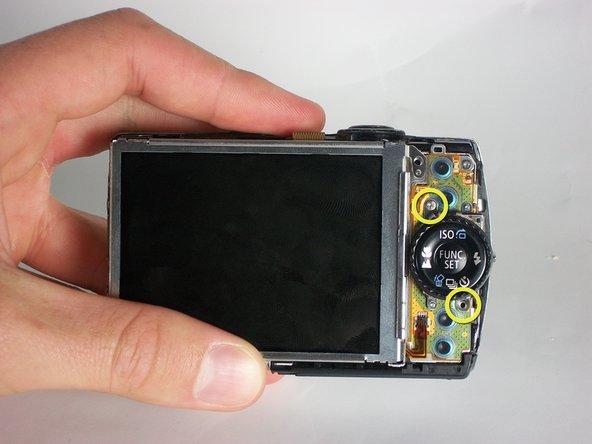 Image 1/3: Remove 2 screws holding metal side guard using screwdriver.