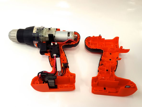 Image 2/3: When separating the drill casing, the black plastic speed switch covering will be removed from the drill automatically.