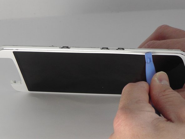 Insert the blue opening tool into the crevice between the screen and the main body of the phone. Gently slide the tool around the edge of the phone.