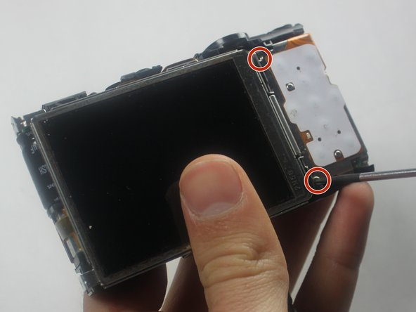 Remove the 2 screws(1.95 mm) by the top right and bottom right of the screen.