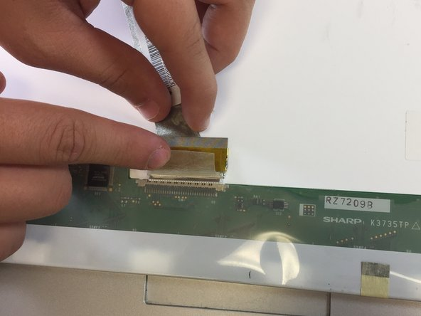 Image 2/3: Pull the wire out of its socket in the display backing.