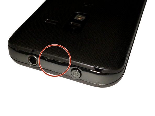 At the top of the device there is a small notch that is used to remove the battery door.