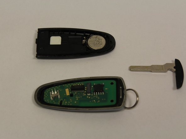 Gently remove the back cover of the key fob.
