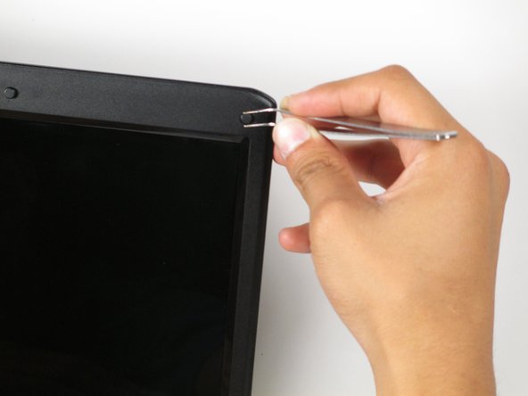 With a pair of tweezers, peel off the six rubber cushions from the bezel located around the perimeter of the screen.