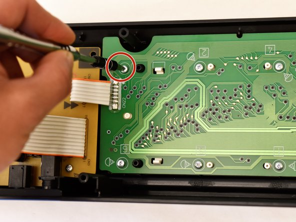 Remove the 19 9mm J head screws from the green button panel by using a J1 screwdriver.