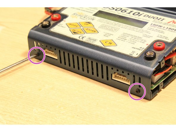 Remove the two screws located on the front side of the charger.