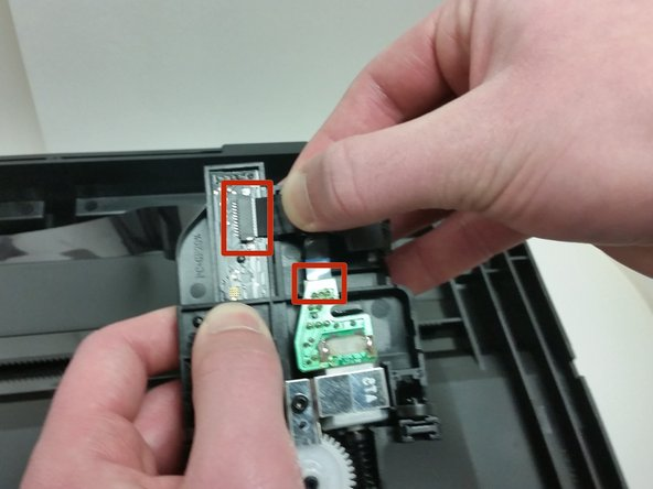 Remove the two ribbon cables from the scanning light.