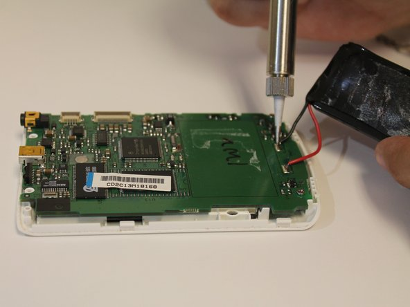 On the NEW motherboard, use a soldering iron to solder the positive and negative terminals to the new motherboard.