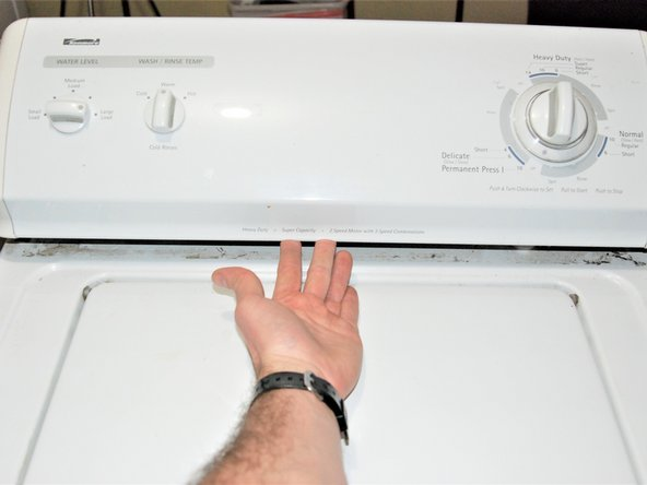 Pull up the control panel located on top of the washer machine.