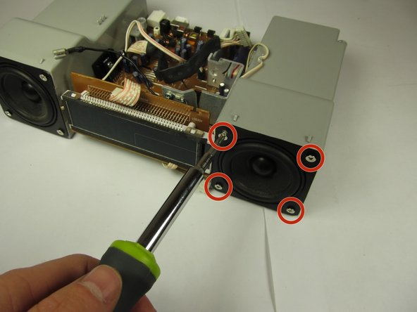 Remove the four 14mm Phillips #1 screws on each of the speaker's four corners.