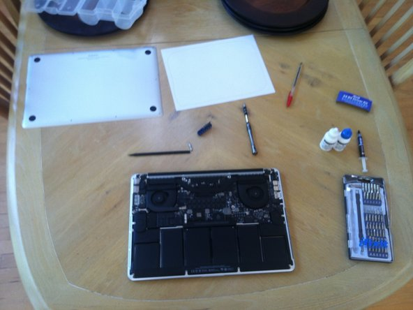 First, take off the rear panel on the Macbook Pro. You will need to use a screwdriver to remove Apple's pentalobe  screws.