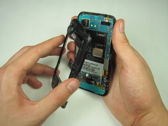 Gently grasp and carefully lift mid panel up and away from the device with your fingers.