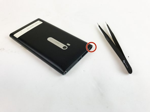 Use tweezers to remove the small rod in the port indicated in the picture.