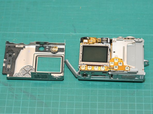 Image 1/2: Thank goodness the camera body is held together by screws for easy disassembly! Many  other Canon PowerShot cameras are constructed similarly.