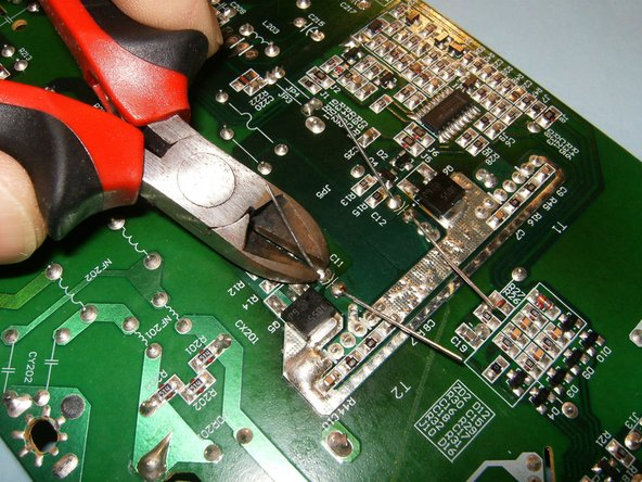 Image 3/3: Once they are soldered, cut the excess with a pair of side cutters or equivalent. All capacitors on this board are exchanged in the same way.