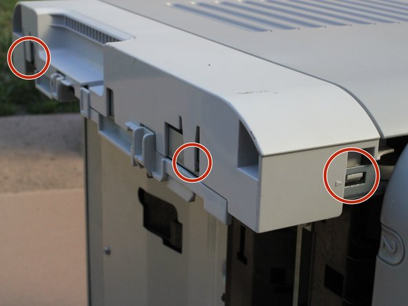 Image 1/2: Some of the press tabs are hard to reach with a finger. If needed, gently press in the tab with a screwdriver until it releases.